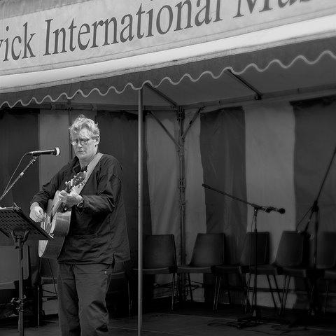 Andrew Lobb, song writer interpreter on stage at Alnwick international music festival 2011